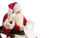 Santa Claus mottar en önskelista Arkivfoto
