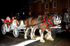 Santa Claus and Mrs. Claus Riding in a Carriage Stock Photo