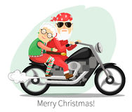 Santa Claus and Mrs.  riding on a steep motorcycle Royalty Free Stock Photo