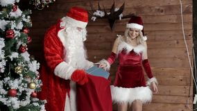 Santa Claus with my niece to prepare the bag with gifts for listening children. Xmas Atmosphere. Christmas and Happy New Year stock video