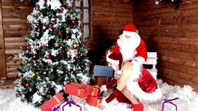 Santa Claus with my niece to prepare the bag with gifts for listening children. Xmas Atmosphere. Christmas and Happy New Year.  stock video