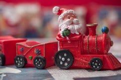 santa Claus na miniatury zabawki pociągu Obraz Royalty Free