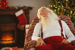 Santa claus napping on the armchair Stock Image