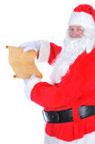 Santa Claus with Naughty List Royalty Free Stock Images