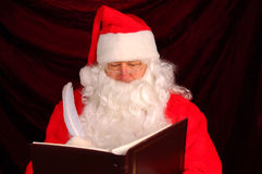 Santa Claus with Naughty and Nice Book Stock Photo