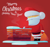 Santa claus near chimney on roof at 2017 new year. Can be used for new year celebration in 2017 or christmas eve postcard. Ideal for new year banner with santa Stock Photo