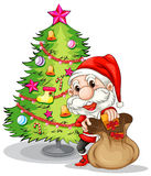 Santa Claus near the christmas tree Royalty Free Stock Photo