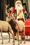 Santa Claus are near his reindeers Stock Images