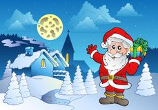 Santa Claus near small village 1 Stock Image