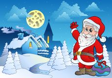 Santa Claus near small village 2 Stock Photo