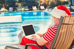 Free Santa Claus Near The Pool Holiday Vacation Concept Stock Images - 158816634
