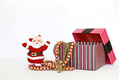 Santa Claus with necklaces in pink gift box Stock Photography