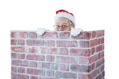 Santa Claus nederlag bak en lampglas Arkivbilder