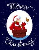 Santa Claus nel camino con il sacco dei regali Fotografia Stock