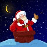 Santa Claus nel camino con il sacco dei regali Immagini Stock