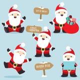 Santa Claus nel Natale di pose di divertimento ha messo 4 Immagini Stock