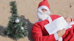 Santa claus new year 2020  change  christmas tree. Hello stock video footage