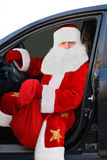 Santa Claus. New Year and Christmas. Santa Claus with a bag sitting in the car. Symbol of the New Year holiday and Christmas Royalty Free Stock Image