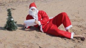 Santa claus 2020 new year christmas celebration symbol. Sand beach stock video footage