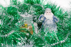 Santa Claus in a new-year shower. Santa Claus is porcelain  in a green new-year shower Royalty Free Stock Images