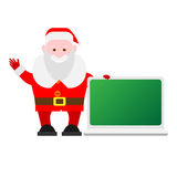 Santa Claus next to a laptop Royalty Free Stock Photo