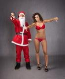 Santa claus and nice girl thumbing down Royalty Free Stock Photos