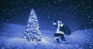 Santa Claus Night Christmas Season Snowing begrepp Royaltyfri Fotografi