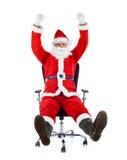 Santa Claus nova que senta-se em uma cadeira do escritório. fotos de stock