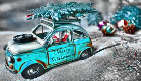 Santa Claus Now on the run with the car on the snow royalty free stock photo