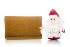 Santa Claus o padre Frost con la tarjeta en blanco del papel del arte Imagen de archivo