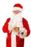 Santa Claus with oatmeal cookies Stock Image