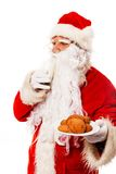 Santa Claus with oatmeal cookies Stock Photos