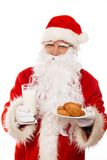 Santa Claus with oatmeal cookies Stock Photography