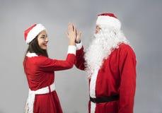 Santa Claus och Claus giril gör ett avtal Arkivbilder