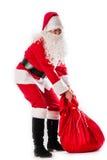 Santa Claus och en tung påse Royaltyfri Bild
