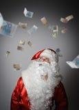 Santa Claus och euro Royaltyfri Fotografi