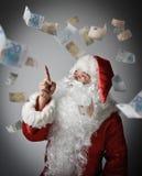 Santa Claus och euro Royaltyfria Bilder