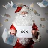 Santa Claus och fallande eurosedlar Hundra eurobegrepp Royaltyfri Fotografi