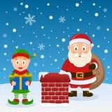 Santa Claus och julälva på ett tak Royaltyfria Bilder