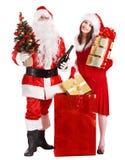 Santa Claus och julflicka. Arkivbild