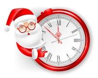 Santa Claus och klocka Arkivbild