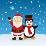 Santa Claus och pingvin med hatten Arkivbilder