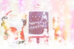 Santa Claus och ren på färgrik bakgrund Royaltyfri Fotografi