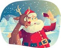 Santa Claus och Rudolph Taking ett foto tillsammans Arkivbild