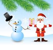 Santa Claus och snöman Arkivbild