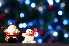 Santa Claus och snowman Arkivfoton