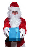 Santa claus offering a blue gift box Stock Photography