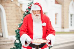 Santa Claus Offering Cookies Royalty Free Stock Images