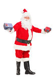 Santa Claus offering gifts Royalty Free Stock Photo