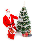 Santa Claus offering present Stock Images